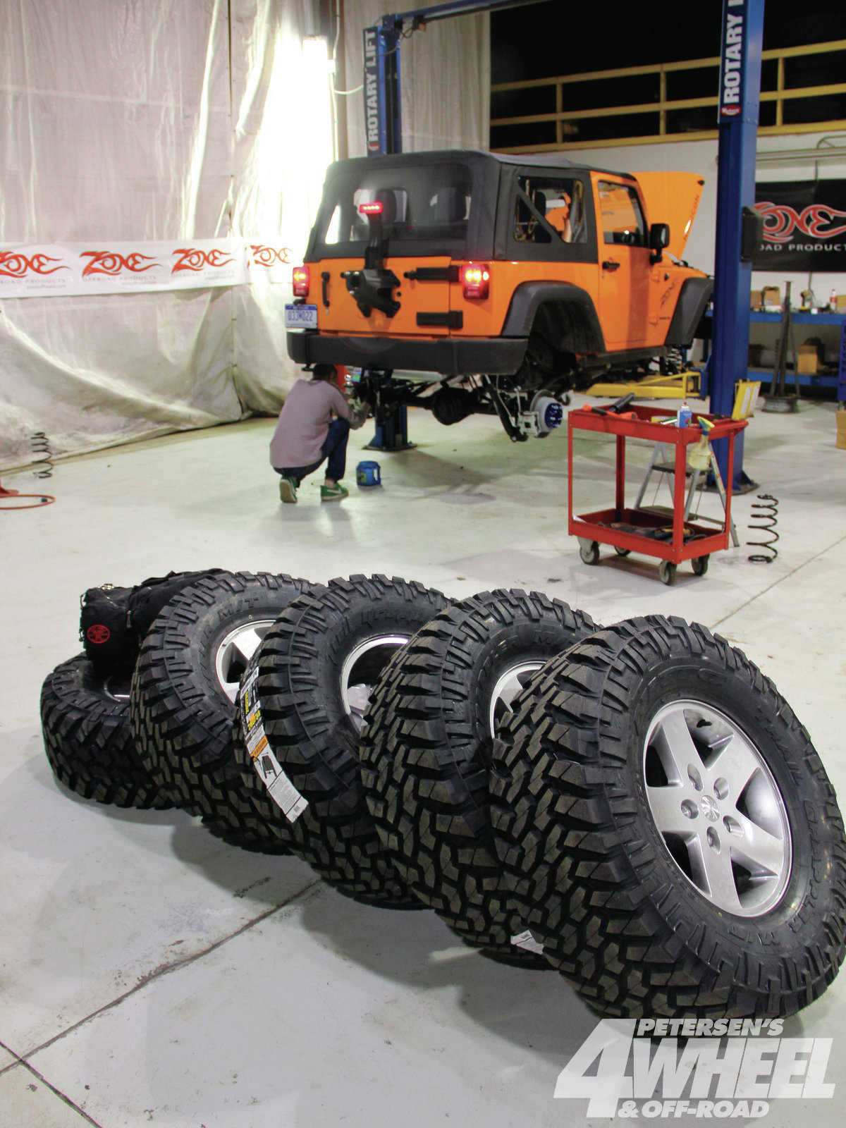 131_1209_10+the_ultimate_orange_jeep_part_2+nitto_trail_grapplers_on_stock_wheels.jpg